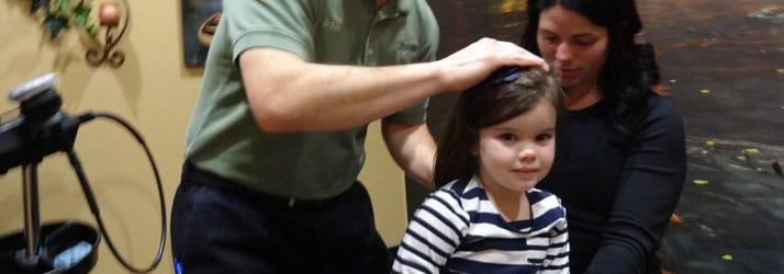 Chiropractor Oak Creek WI Daniel Hyatt Child Adjustment